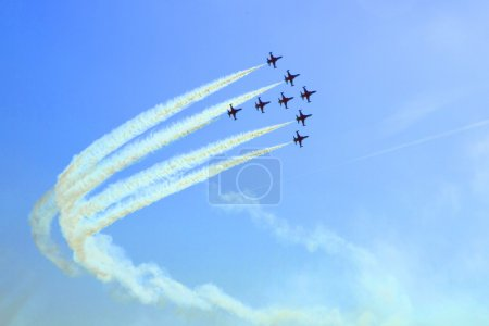 Arircraft show on the blue sky