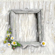 Retro photo framework with flowers on textured bac...