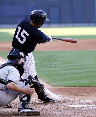 Baseball player watching his hit