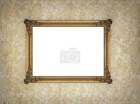 Golden frame over vintage wallpaper.