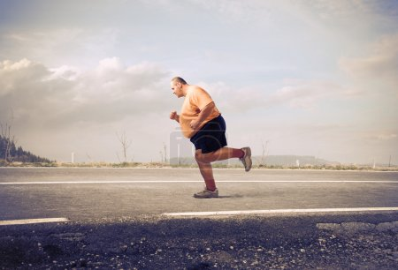 Fat man jogging on a country road...