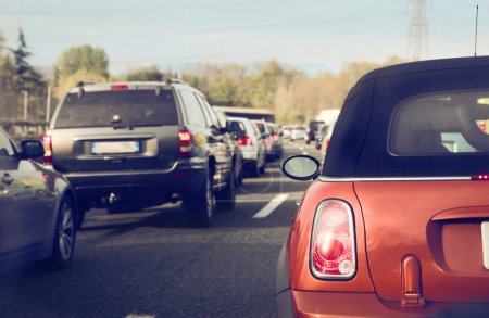 Photo for Cars stuck in the traffic on a highway - Royalty Free Image