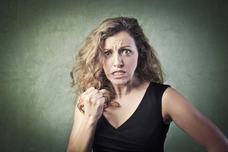 Photo for Portrait of a woman with aggressive expression - Royalty Free Image