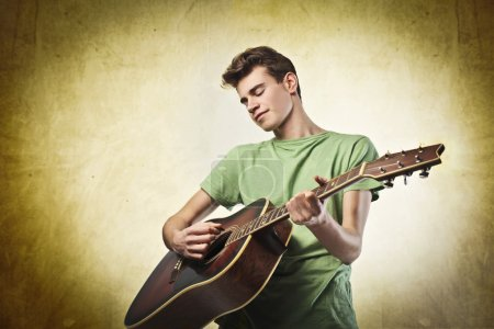 Photo for Young man playing the guitar - Royalty Free Image