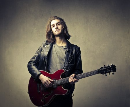 Photo for Young man playing the electric guitar - Royalty Free Image