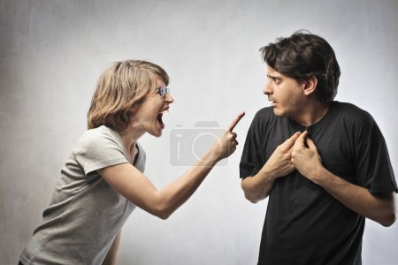 Angry woman pointing her finger against her husband