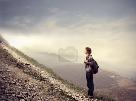 Photo for Young man about to climb uphill - Royalty Free Image