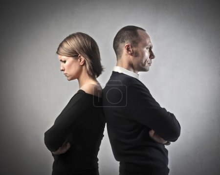 Photo for Man and wife turning their back on each other - Royalty Free Image