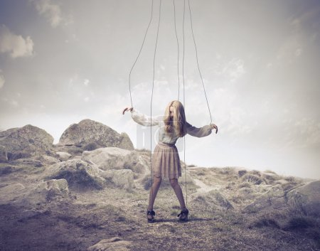 Young woman bound to ropes as a puppet...