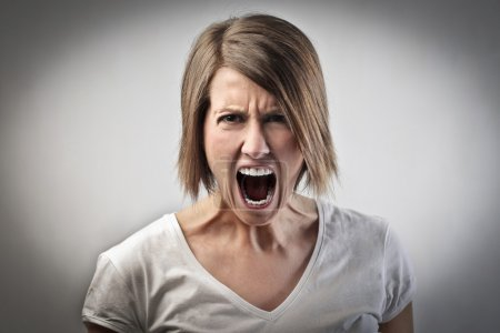 Photo for Portrait of a furious woman screaming - Royalty Free Image