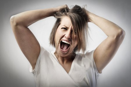 Photo for Furious young woman shouting - Royalty Free Image