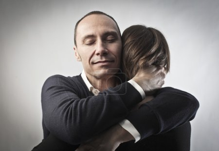 Photo for Man hugging his wife - Royalty Free Image