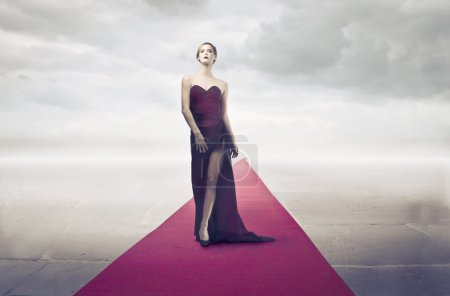 Photo for Beautiful elegant woman on the red carpet - Royalty Free Image