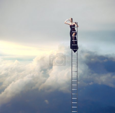 Photo for Beautiful elegant woman on a ladder looking far away - Royalty Free Image