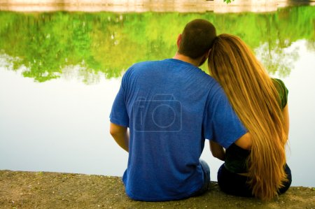 Photo for Vibrant image of two lovers on lakeside - Royalty Free Image