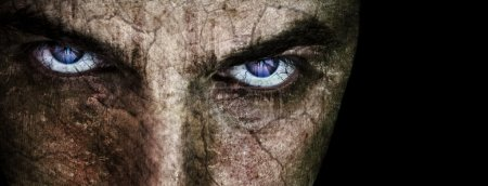 Photo for Cracked face with sinister evil scary eyes over black - Royalty Free Image