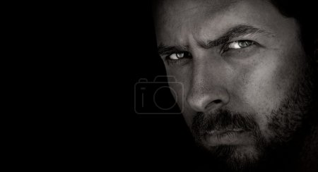 Photo for Low-key portrait of scary man with evil eyes - Royalty Free Image