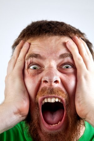 Win concept - scream of happy amazed man