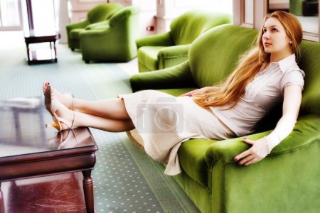 Beautiful woman relaxing on comfortable couch