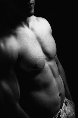 Muscular torso and abdomen of man with sexy body