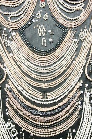 Photo for Many shiny decorative jewels at souvenir market - Royalty Free Image