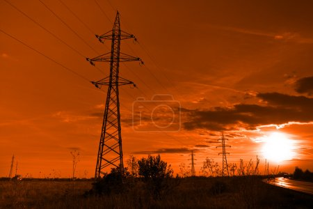 Sun and electricity - powerlines towers at sunset