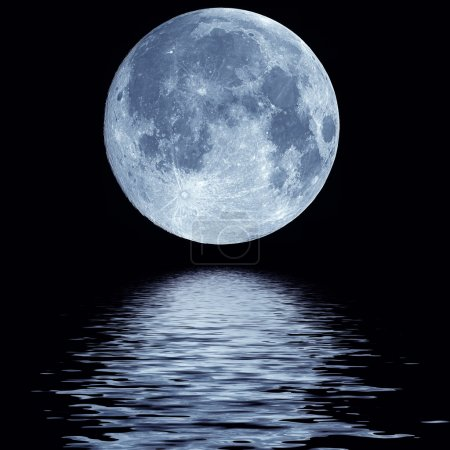 Photo for Full blue moon over cold night water - Royalty Free Image