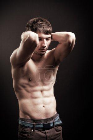 Sexy shirtless man with muscular abdomen