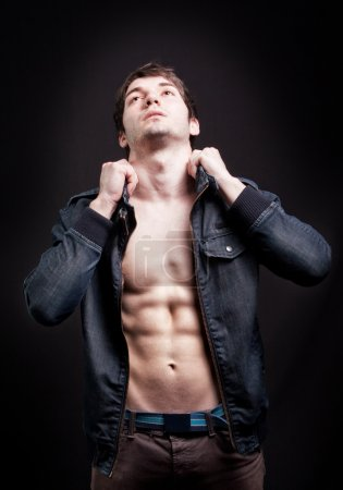 Photo for Fashion shot of sexy man with muscular abdomen - Royalty Free Image