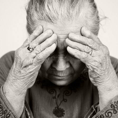 Photo for Unhappy old senior woman with health problems - Royalty Free Image
