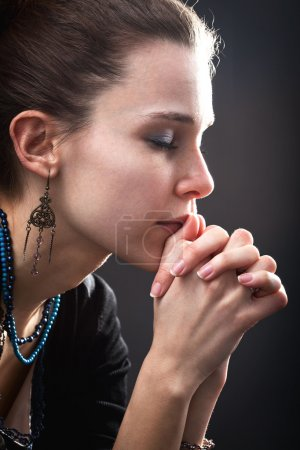 Photo for Religion concept - woman and her prayer over black - Royalty Free Image