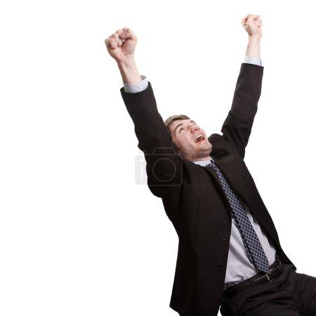 Photo pour Concept de victoire et succès - victorieuse jeune homme d'affaires - image libre de droit