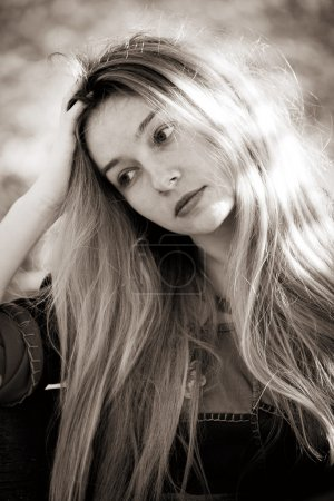 Photo for Sad depressed young woman in sepia style - Royalty Free Image