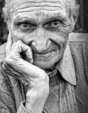 Old senior man with wrinkled face