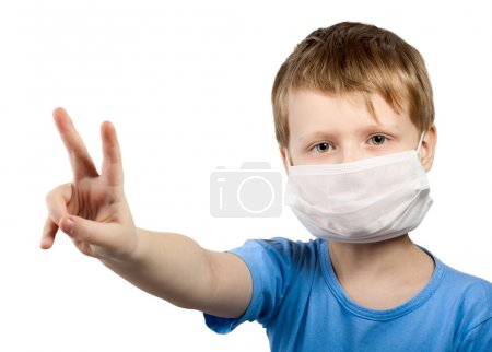 Flu illness child boy in medicine healthcare surgical mask isolated over wh