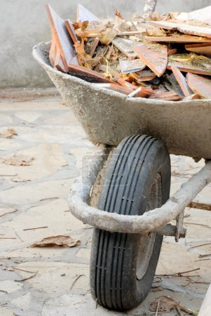 Wheelbarrow with waste