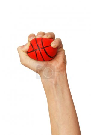 Photo for One isolated hand squeezes small sponge basketball toy ball over white background - Royalty Free Image