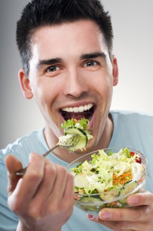 Photo for Young men eating salad close up shoot - Royalty Free Image
