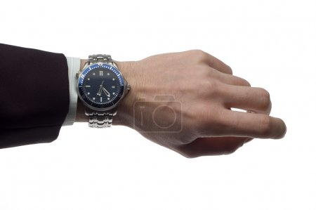 Photo pour Main de l'homme d'affaires avec montre-bracelet sur blanc - image libre de droit