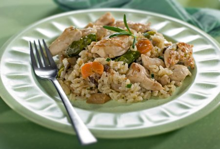 Photo for Chicken risotto with asparagus mushroom and carrot close up - Royalty Free Image