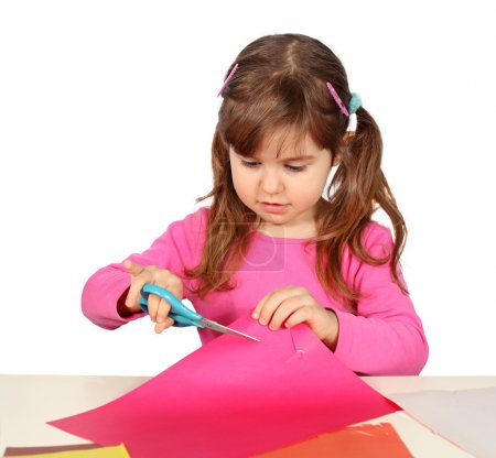 Little Child Girl Cutting with Scissors over White...