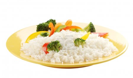 Photo for Boiled rice with vegetables on a yellow plate - Royalty Free Image