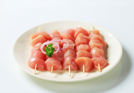 Photo for Pieces of raw chicken meat on skewers - Royalty Free Image