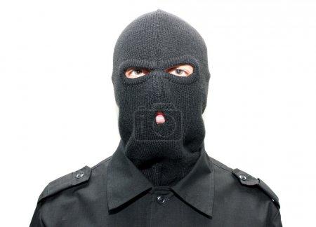 An burglar wearing a ski mask (balaclava)...