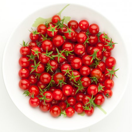 Photo for Plate with cherry tomatoes isolated on white - Royalty Free Image