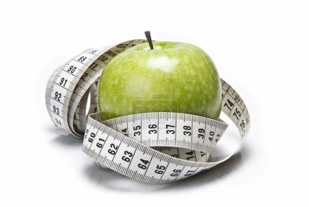 Tape measure and apple.