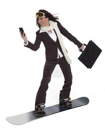Geschäftsfrau auf einem Snowboard