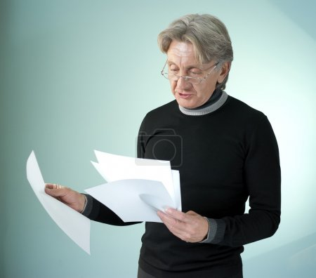 Man reading impormant papers