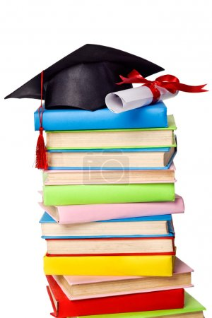Photo for Cap and diploma on top of stack of books. Isolated - Royalty Free Image