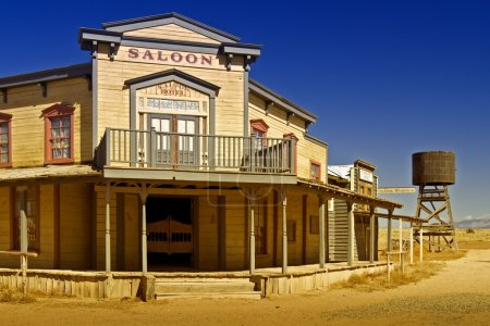 Saloon, telegraph office and wooden water tower al...